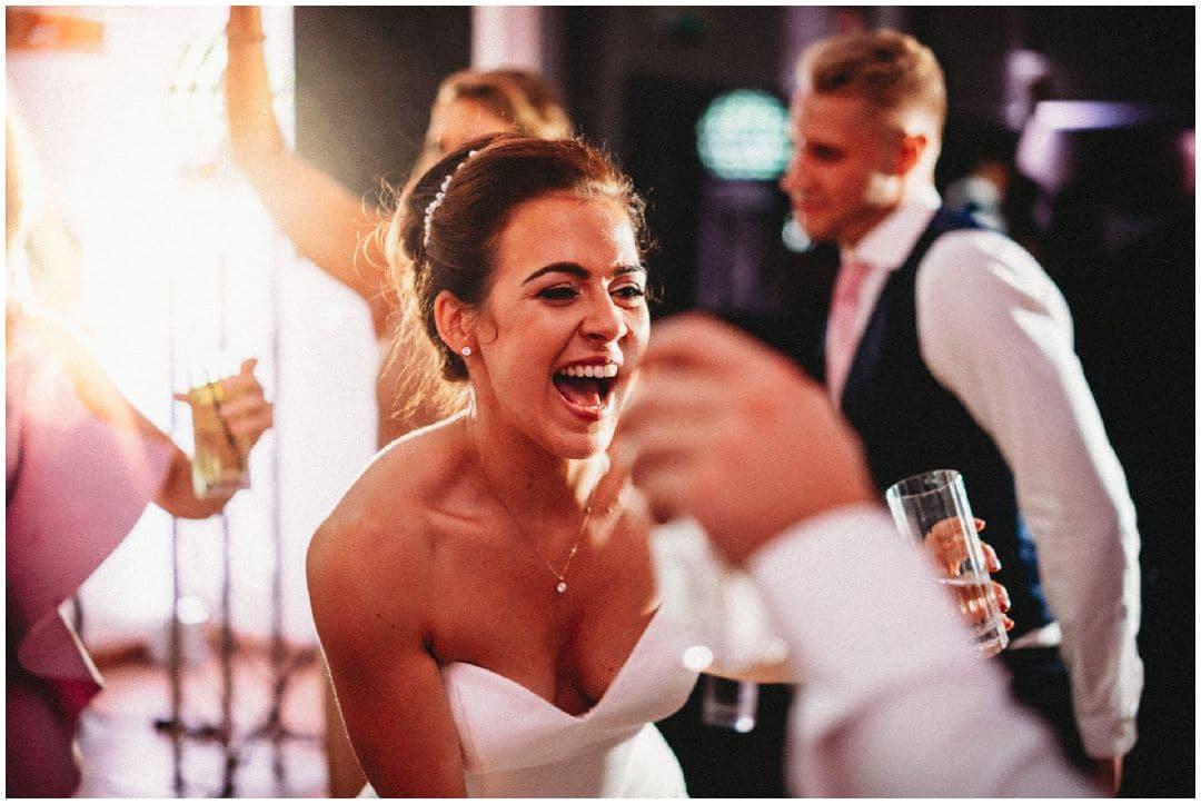 MILLBRIDGE COURT WEDDING PHOTOGRAPHY bride on the dance floor